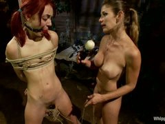 Naked pigtailed redhead Zoe Voss gets tied up and fucked hard by large titted lesbian domina Felony. Crazy domme fucks submissive Zoe Voss in the ass.