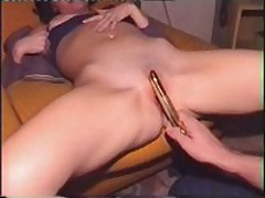 Golden sex toy in the vagina